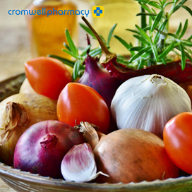 Bowl of onions, tomatoes, garlic and rosemary