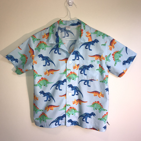 Boys shirt:  Blue background, dinosaur print. - SIZE 10
