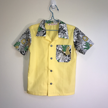 Boys Shirt:   Yellow with animal print collar, sleeves and pocket - SIZE 5