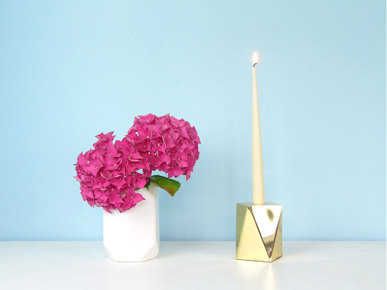 Brass geometric candle holder with white taper