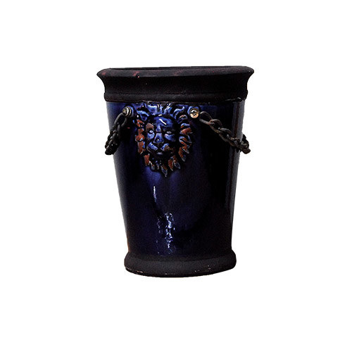 Bright navy ceramic pot with lion motif