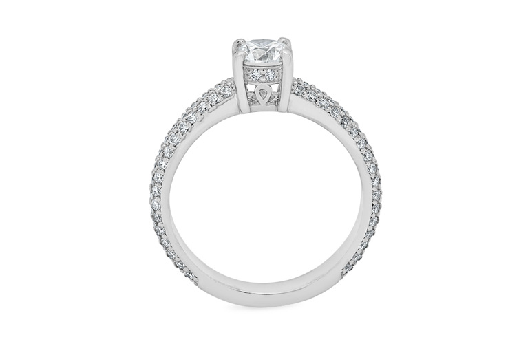 Brilliant cut solitaire engagement ring with pave set diamond band