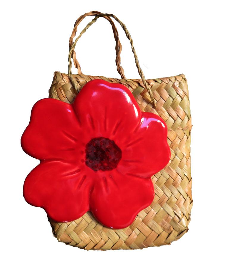 Brilliant red ceramic poppy in kete bag
