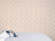 Bunny wallpaper on pink background with bed and velveteen rabbit