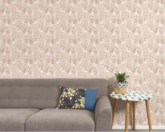Bunny wallpaper on pink background with couch, table and plant