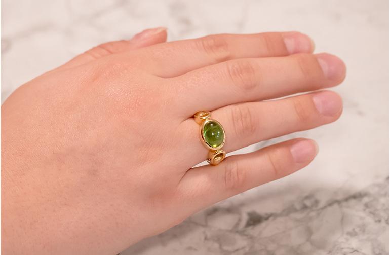 Cabochon green tourmaline yellow gold dress ring