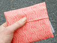 carry pouch peach colour reusable cotton shopping bag folded in hand