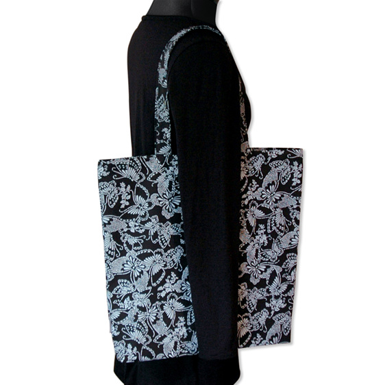 carry pouch white butterflies on black reusable cotton shopping bag worn