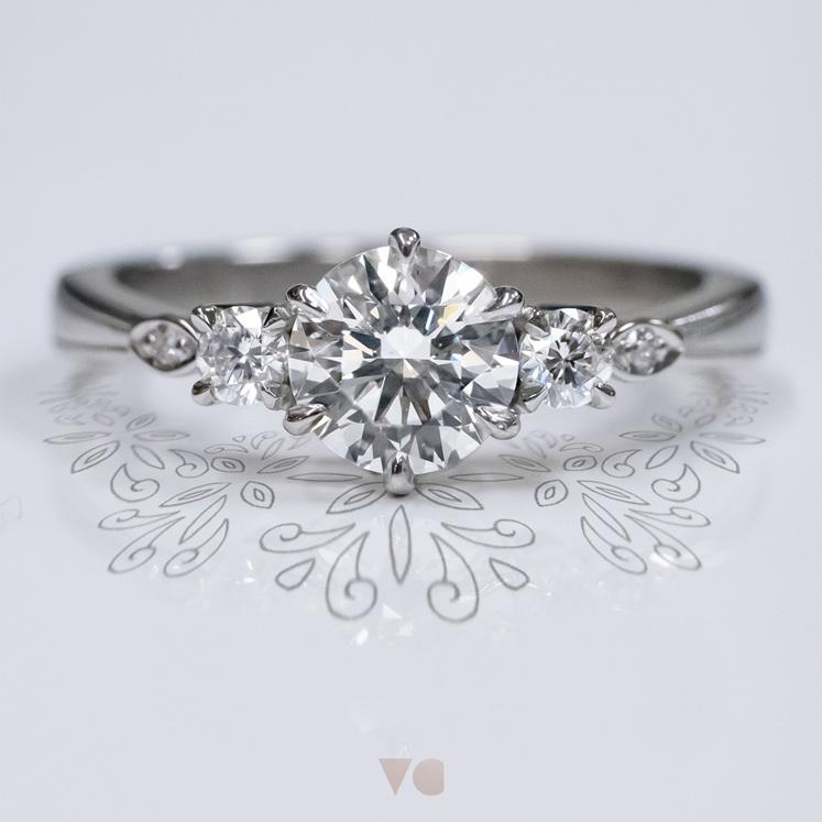 Celtic inspired diamond three stone ring 18ct white gold platinum milgrain edge