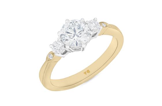 Celtic inspired diamond three stone ring 18ct yellow gold platinum milgrain edge