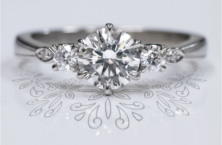 Celtic inspired platinum 18ct white gold diamond three stone engagement ring