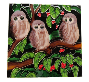 Ceramic wall art three morepork chicks on a Puriri tree branch