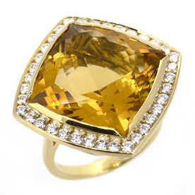 Citrine yellow gold ring with diamond halo