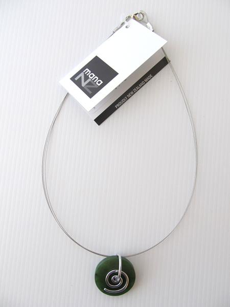 CKA944 Round greenstone pendant with silver koru on silver wire.