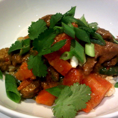Coconut infused dry lamb jungle curry served on brown rice