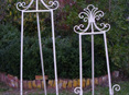 cream wrought iron easels wedding and event hire