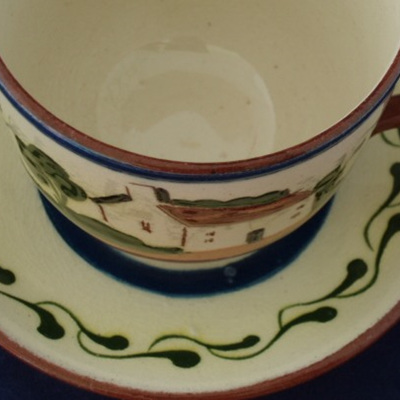 Cup and saucer in motto ware