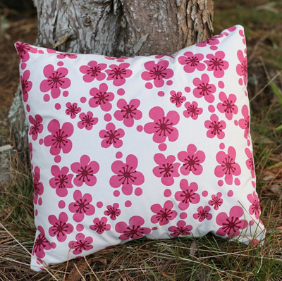 Cushion cover with Manuka flowers on Natural coloured fabric.