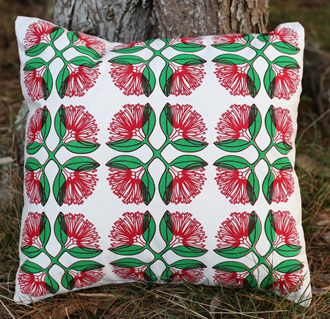 Cushion cover with Pohutukawa flowers on Natural coloured fabric.