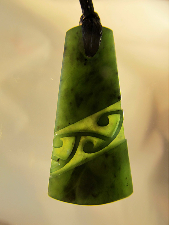 D121 Wedge shaped greenstone pendant with diagonal pattern