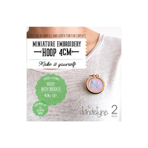dandelyne hoop brooch