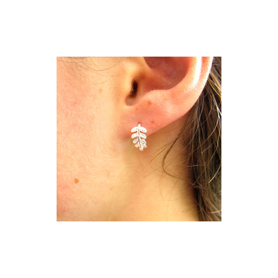 Delicate curled sterling silver fern earrings.