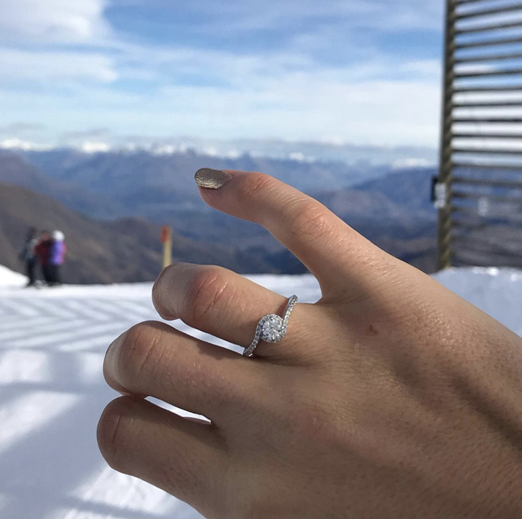Diamond solitaire crossover shoulders and halo engagement ring snow ski mountian