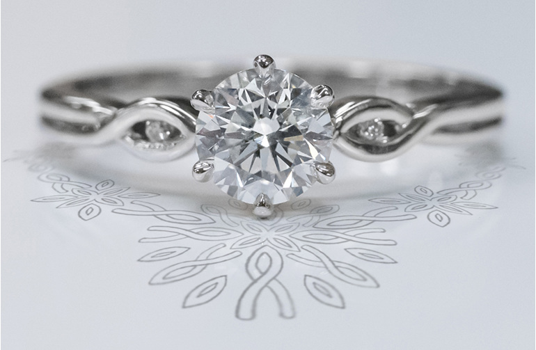 Diamond solitaire engagement ring crossover diamond accent band in platinum