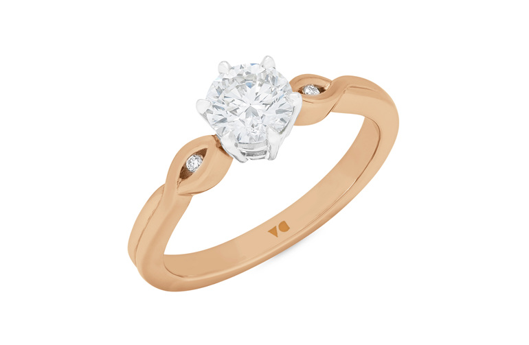 Diamond solitaire engagement ring in 18ct rose gold and platinum