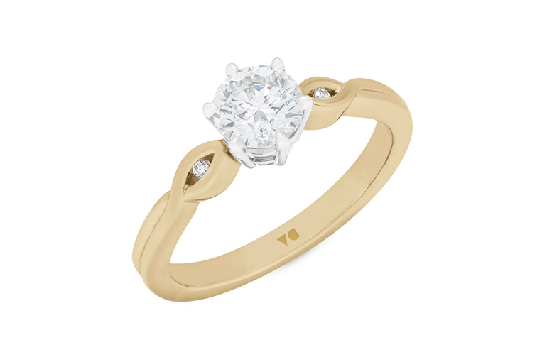 Diamond solitaire engagement ring in 18ct yellow gold and platinum