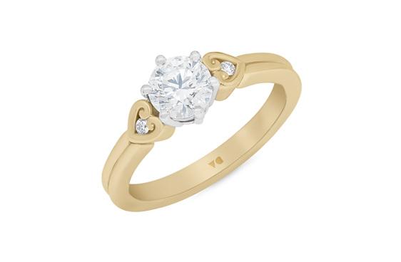 Diamond solitaire engagement ring in 18ct yellow gold platinum koru heart detail