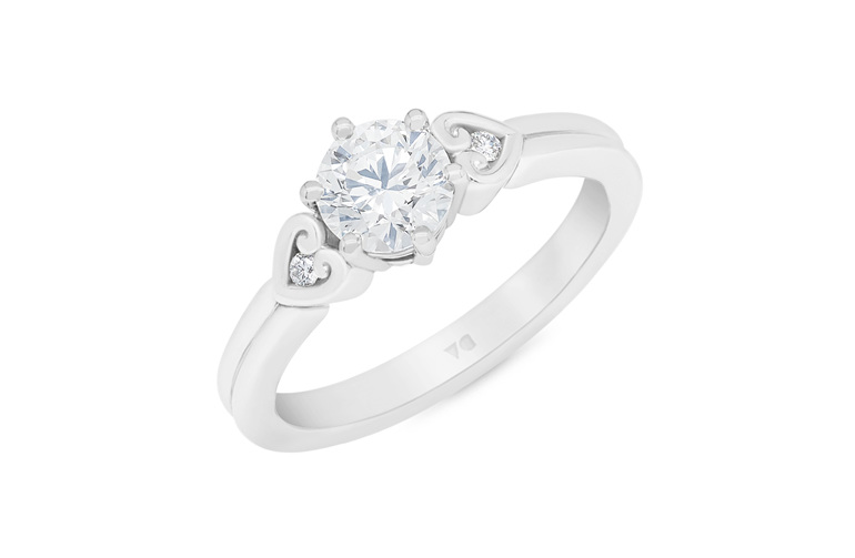 Diamond solitaire engagement ring with koru heart band details platinum gold