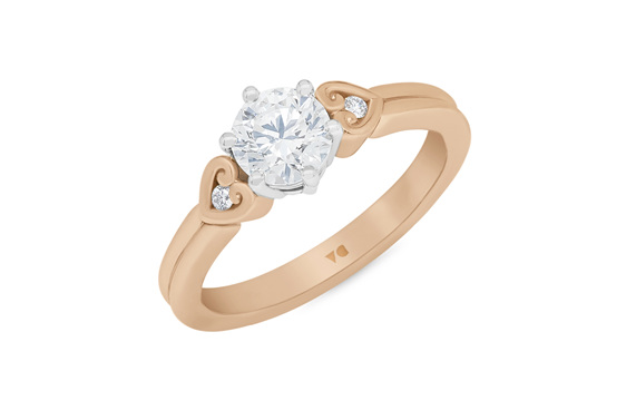 Diamond solitaire engagement ring with koru heart band details
