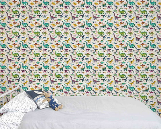 Dinosaur wallpaper in kids room with a bed