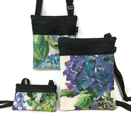 Dory handbags in 3 sizes are flat handbags great for out walking or everyday use