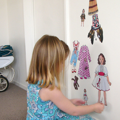 Dress up doll with four outfits wall decal