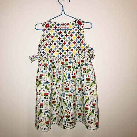 Dress with white background kereru and pohutukawa - Size 2 Toddler