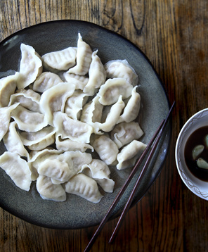 Dumplings on a plate with chopsticks