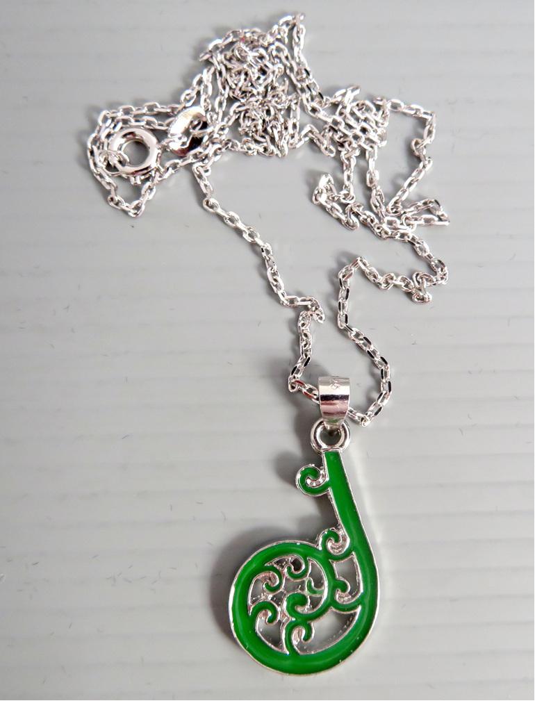 Enamel Koru pendant on a silver chain
