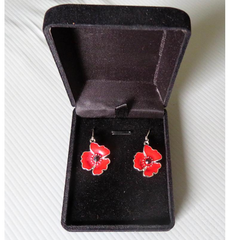 Enamel poppy earrings in a jewellery box