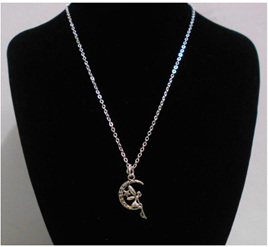 Fairy Sitting Within the Star & Moon Necklace