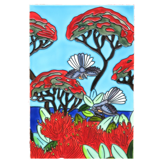 Fantails in amongst the flowers of a Pohutukawa tree