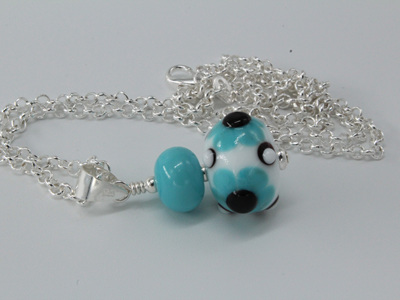 Flower pendant - turquoise/white/black