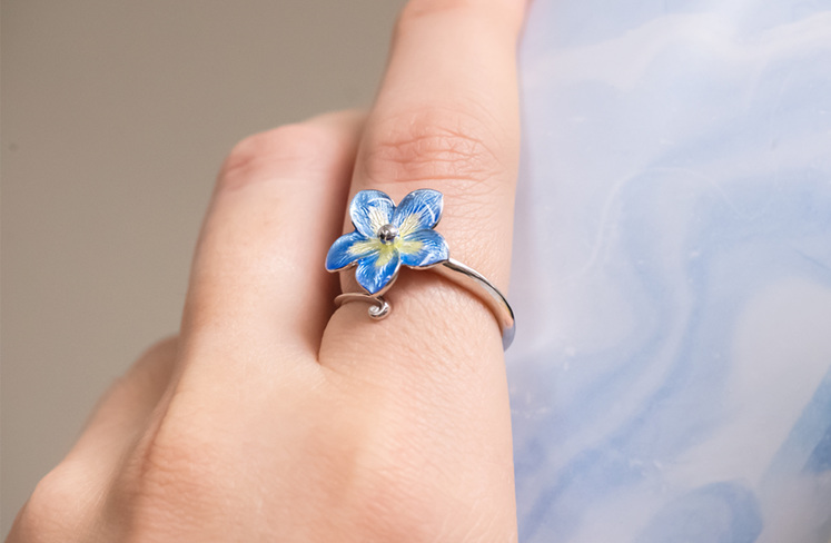 Forget me not blue ring on hand