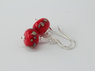 Frit earrings - Iris orange raku frit on light red