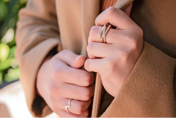 Geometric Diamond Stacking Rings on Hand in Winter Coat