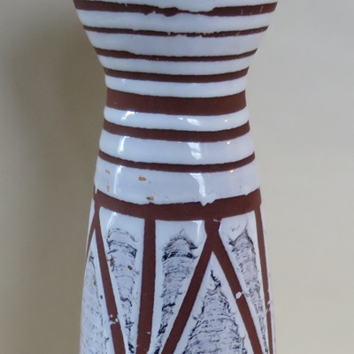 Terracotta with a heavy white glaze