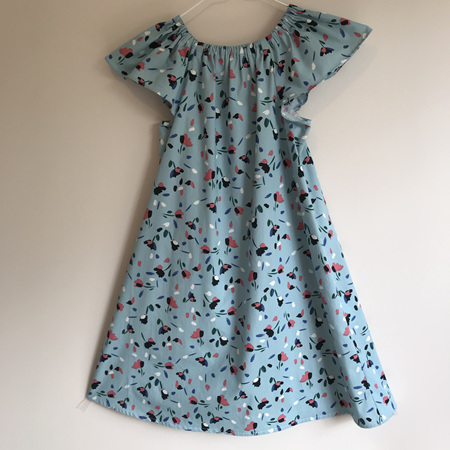Girls Peasant Dress: Blue background with multi-coloured flowers. Puff or Flutter sleeve.  - SIZE 7