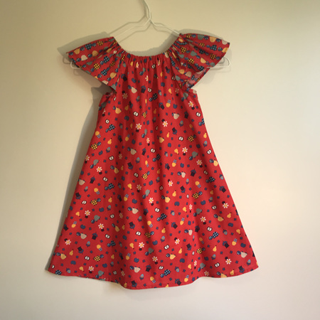Girls Peasant Dress: Red with tortoise print and flutter sleeves. - SIZE 2