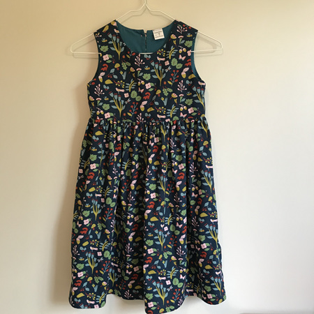Girls summer dress:  Navy background; Garden/woodland print - SIZE 7